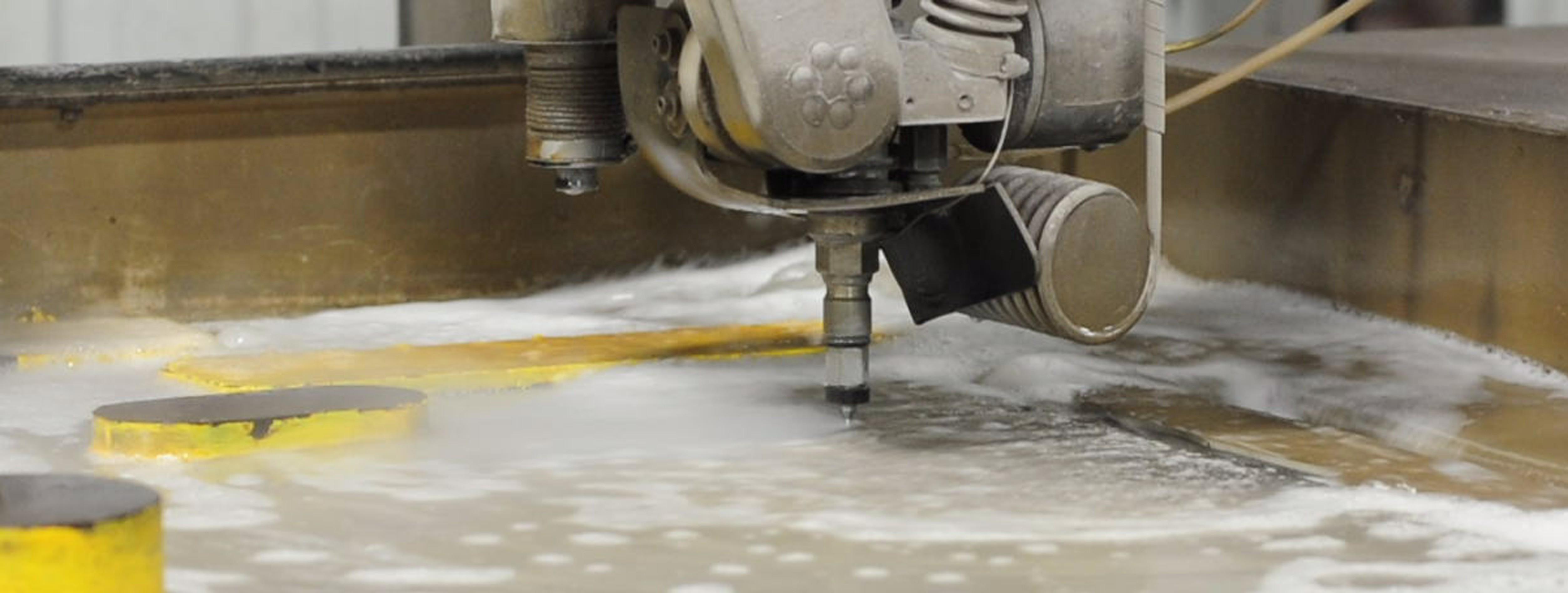 Water jet cutting metal.
